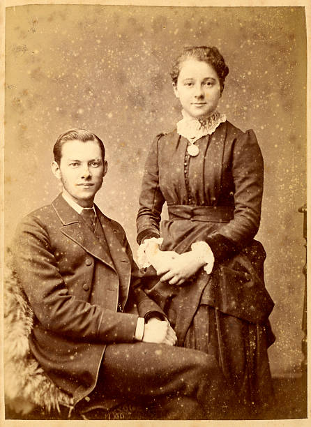 Victorian Young Couple Vintage Photograph Vintage photograph of a young man and woman from the Victorian era circa 1880. 19th century stock pictures, royalty-free photos & images