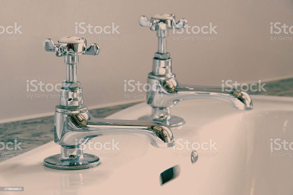 Victorian-style basin taps stock photo