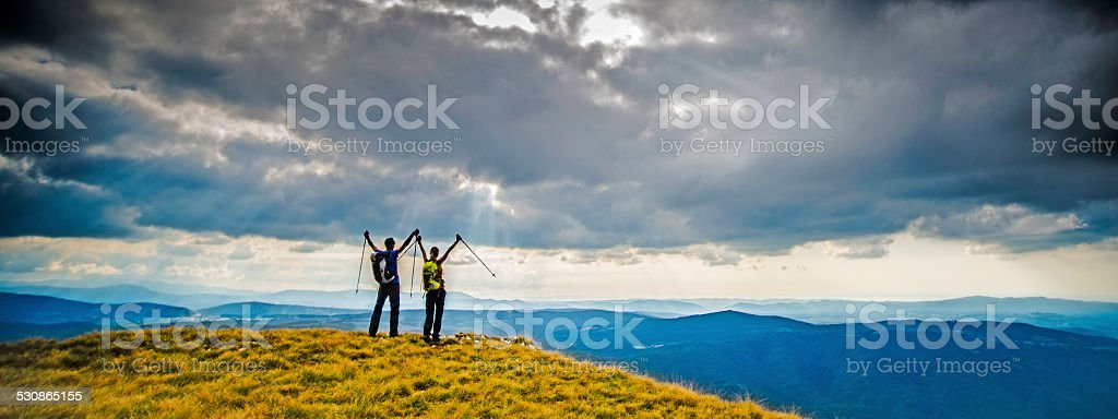 Victorious Couple On Top of a Mountain stock photo