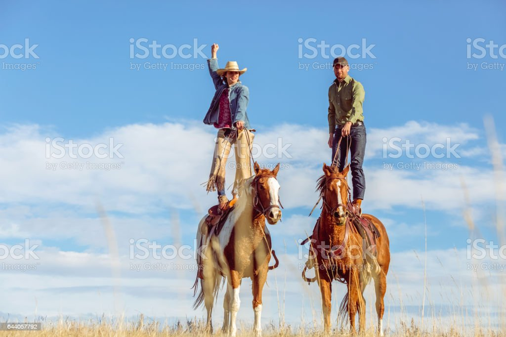 Victorious Cowgirl stock photo