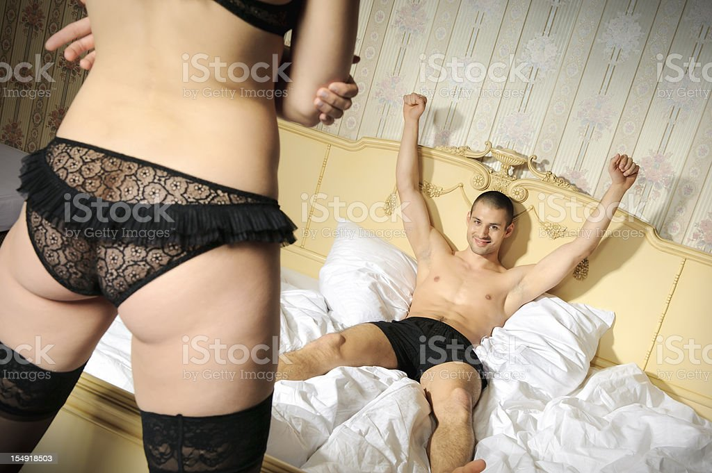 Victorious man lying and woman's back royalty-free stock photo
