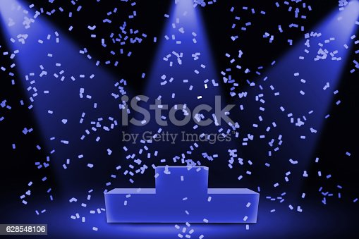 1051699126 istock photo victory ceremony with blue spotlights 628548106