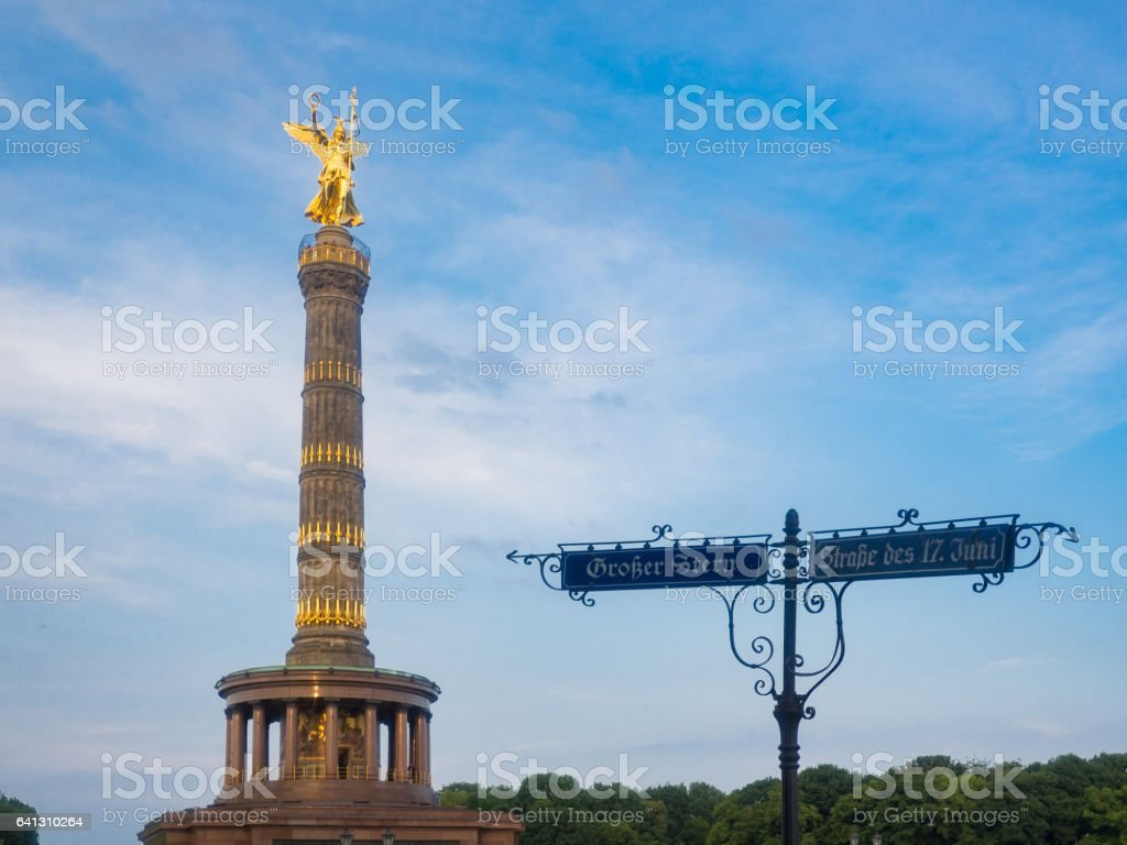 Victory Column with an old road sign in Berlin stock photo