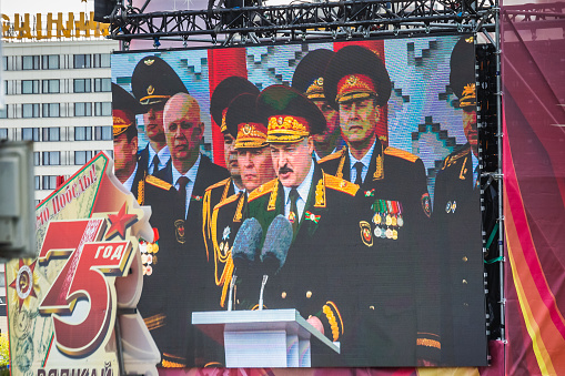 Alexander Lukashenko the president of Belarus and spectators at the celebration of the 75th anniversary of the victory in the Great Patriotic War, parade of May 9 in Minsk, Belarus. Minsk, Belarus - May 9 2020.