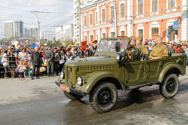 Victory Day parade in Tyumen. Russia Tyumen, Russia - May 9. 2008: Parade of Victory Day in Tyumen. Soldiers in World War 2 uniform go on the SUV of those times willys stock pictures, royalty-free photos & images