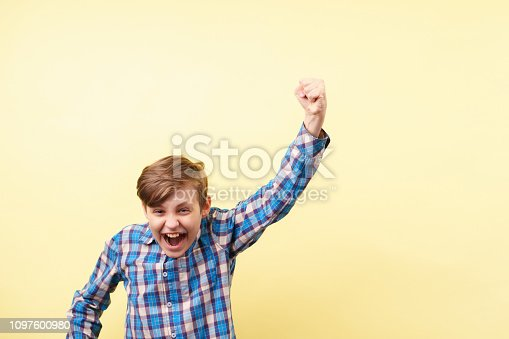 1045527172 istock photo victory, success.excited boy making win gesture 1097600980