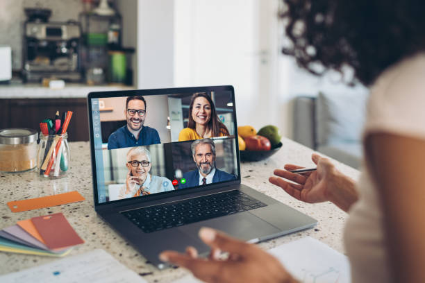 Video business meeting Group of business persons having a video conference zoom stock pictures, royalty-free photos & images