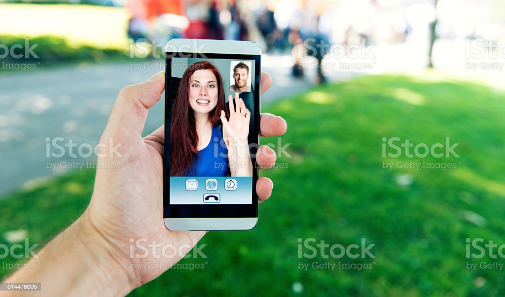 Video call on mobile phone between man and woman stock photo