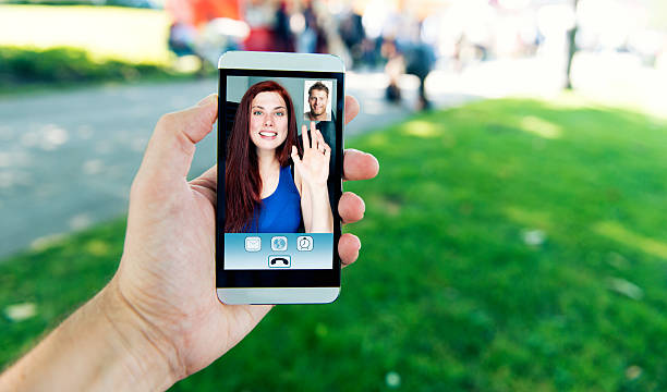 video call on mobile phone between man and woman - video call bildbanksfoton och bilder