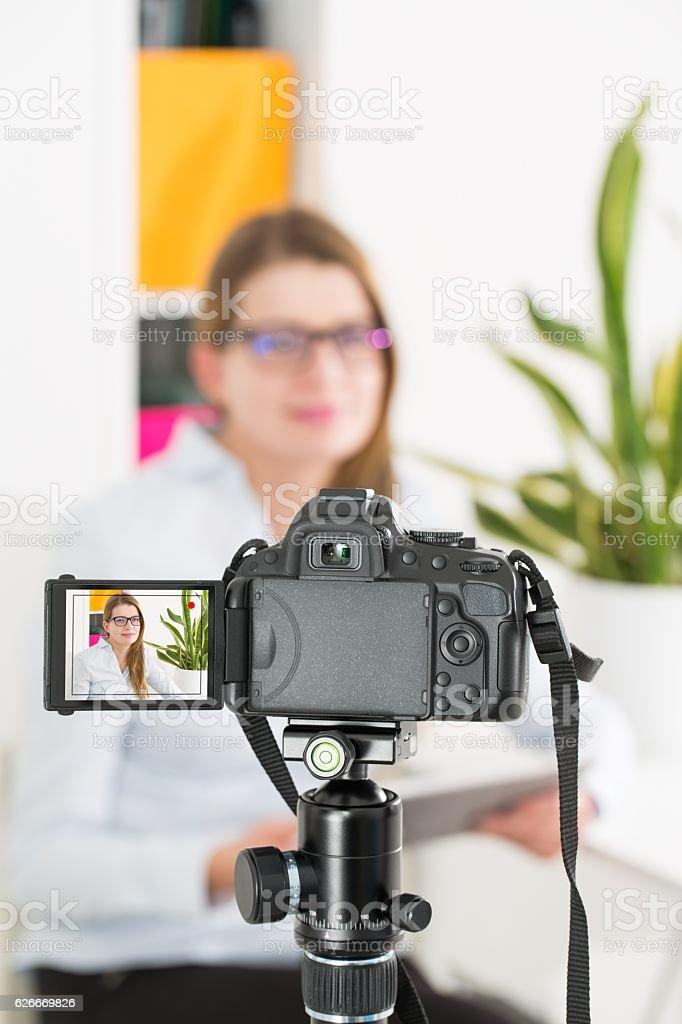Video camera blog recording. Vlog blogger woman. stock photo