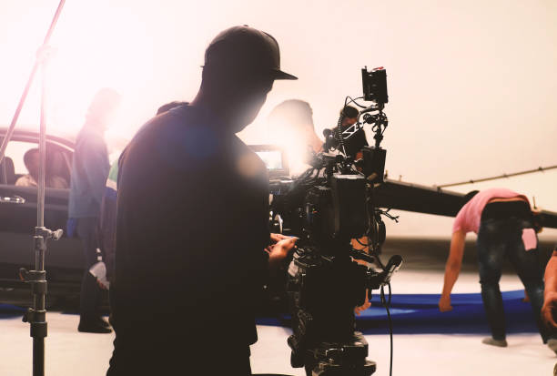 video camera in film or movie production on tripod and professional gear which shooting in location or studio with crew team and beautiful prop or set and ready to online live broadcast or tv on air - filming stock pictures, royalty-free photos & images