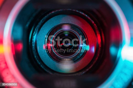 Video camera lens lit in red and blue