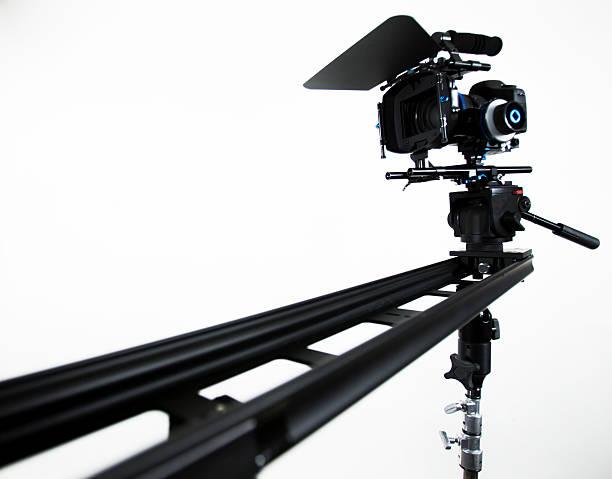 DSLR video camera on portable slider, white background stock photo