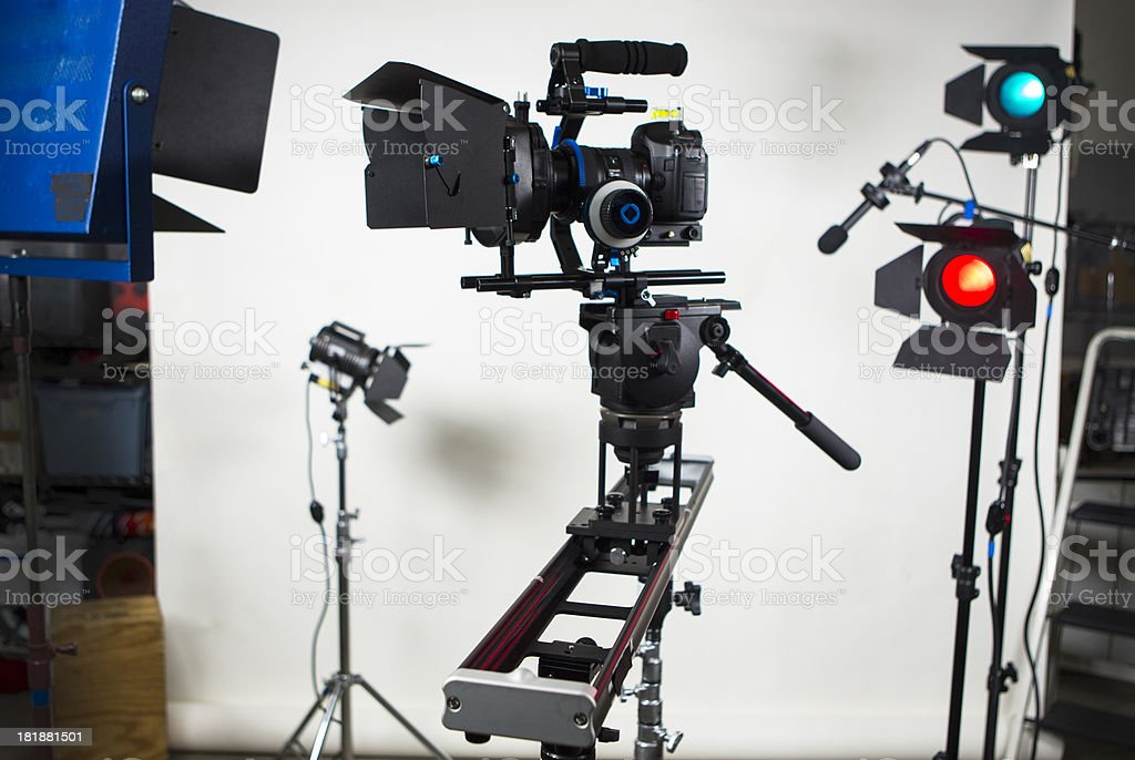 DSLR video camera on slider, studio production gear stock photo
