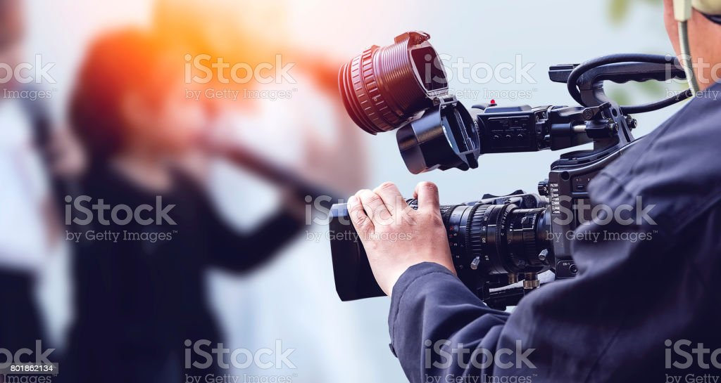 Video camera operator working with his equipment royalty-free stock photo