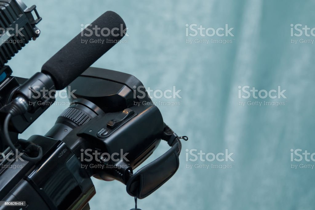 Video camera operator working with his equipment Video camera taking live video streaming at people working background stock photo