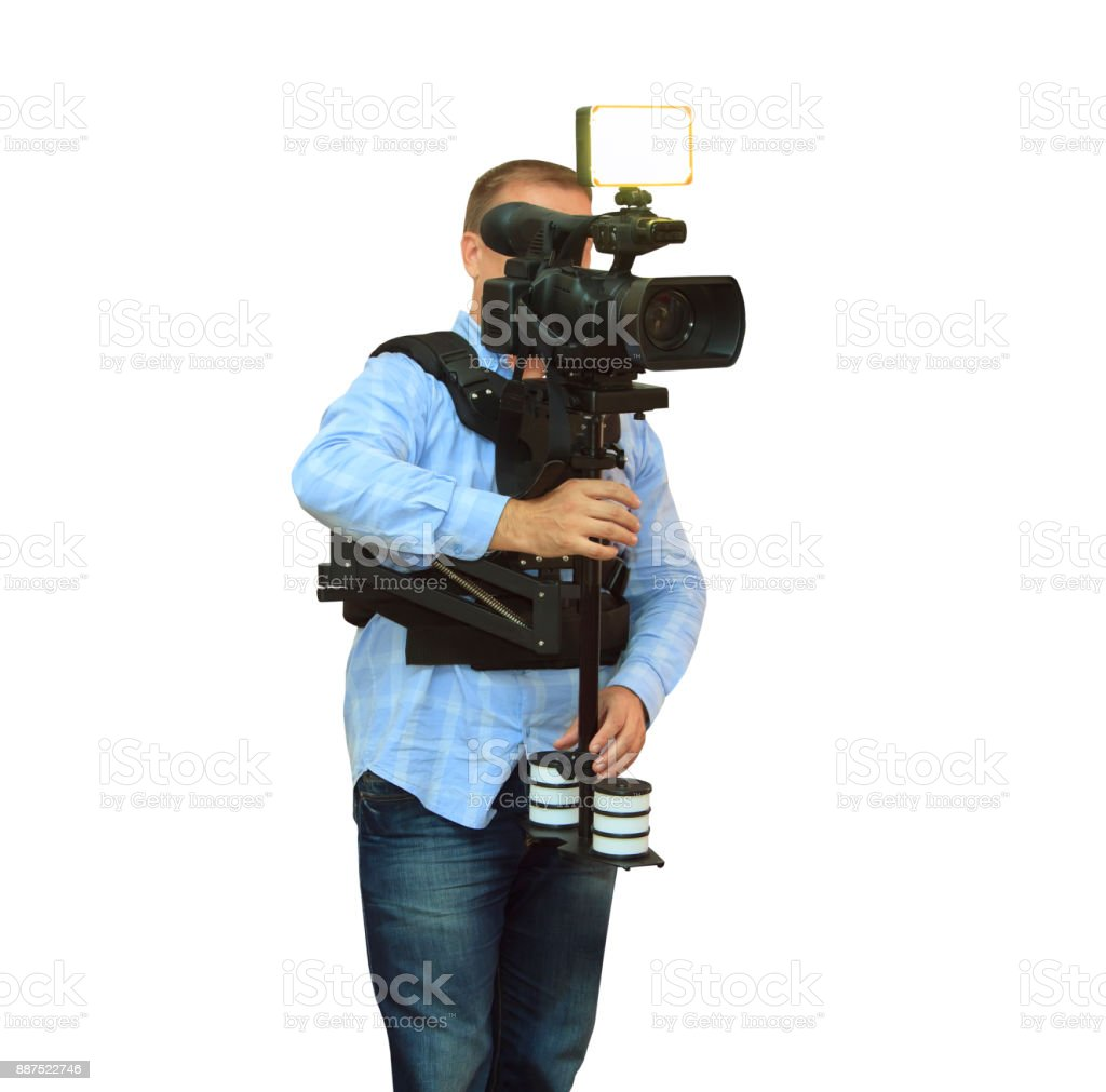 Video camera operator working with his professional equipment stock photo