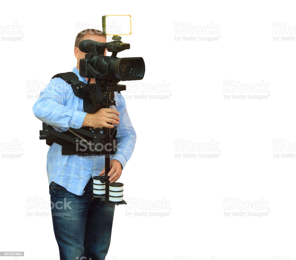 Video Camera Operator Working With His Professional Equipment Stock Of A Royalty Free Photo