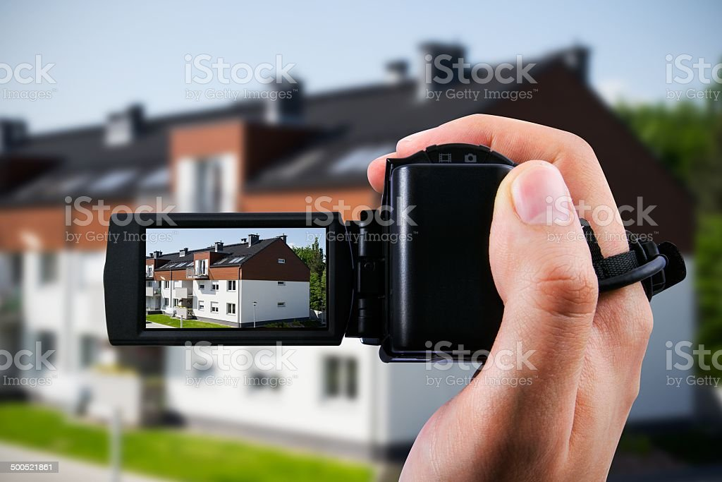 Video camera or camcorder recording new house stock photo