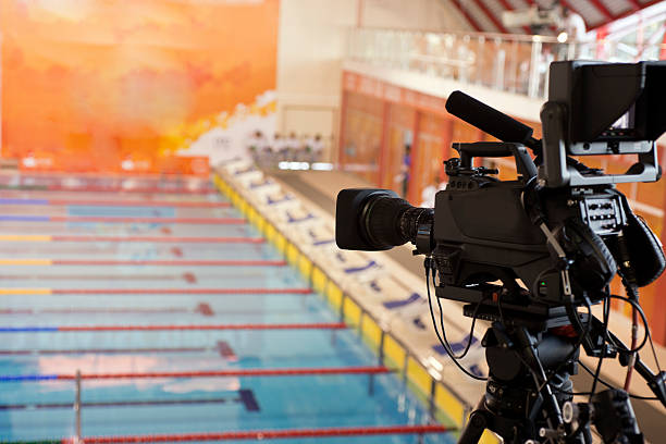 Video camera pointed at a swimming pool stock photo