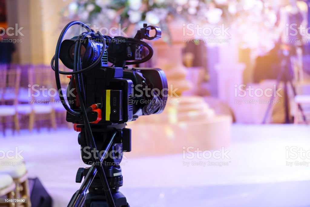 Video camera recording at television broadcast events stock photo