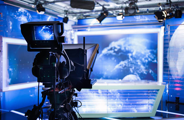 Video camera - recording show in TV studio stock photo