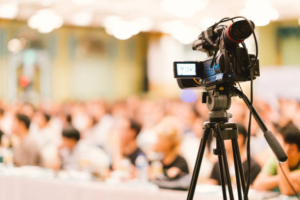 video camera set record audience in conference hall seminar event. company meeting, exhibition convention center, corporate announcement, public speaker, journalism industry, or news reporter concept - filming stock pictures, royalty-free photos & images