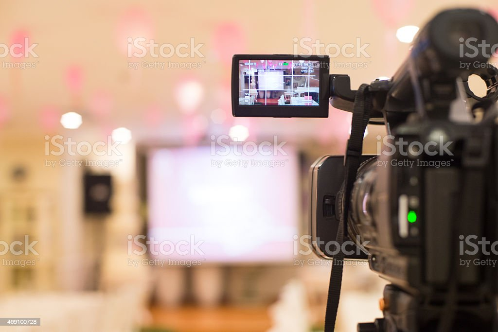 Video camera set up to film a presentation or event stock photo