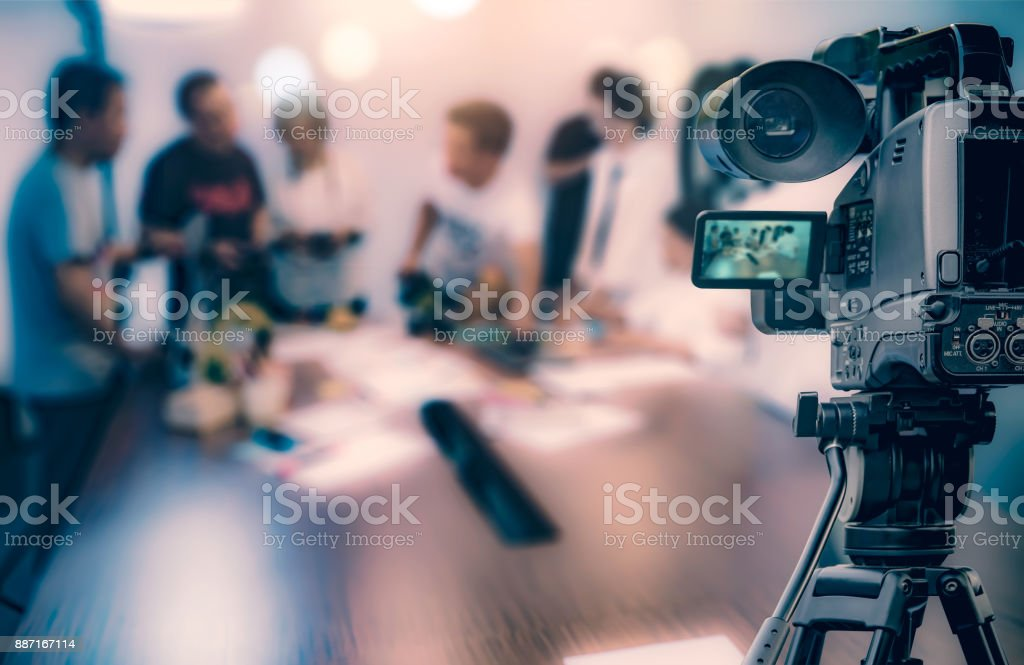 Video camera taking live video streaming at people working background stock photo