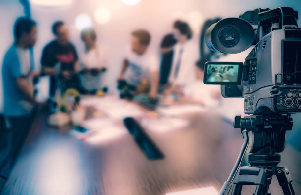video camera taking live video streaming at people working background - camera photographic equipment stock photos and pictures