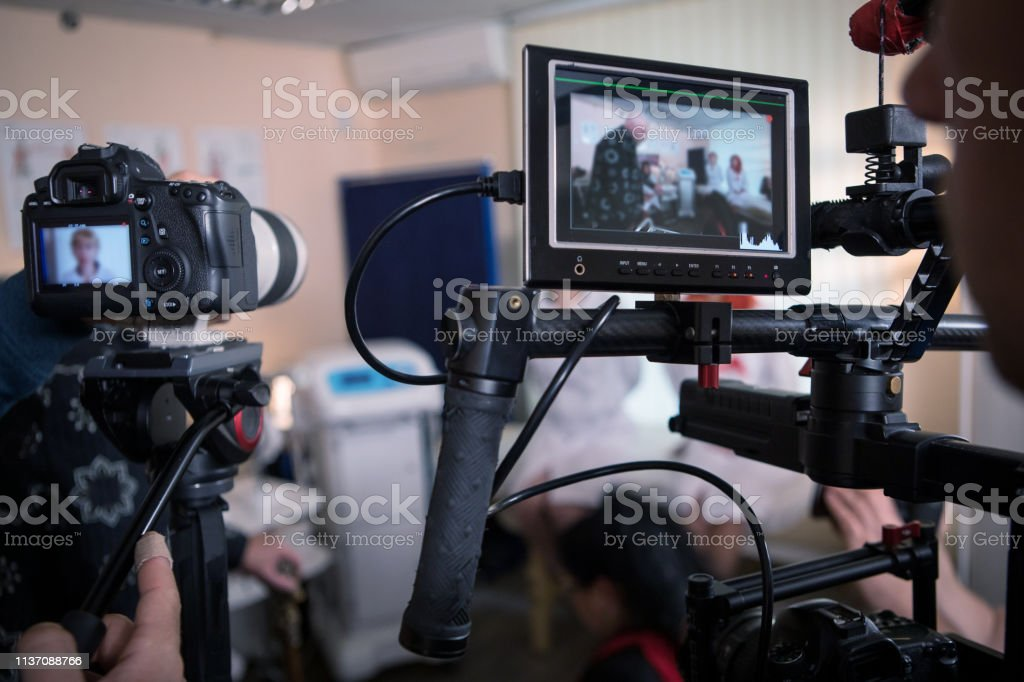 Video cameras on the set, backstage movie scenes Video cameras on the set, backstage of the movie scene, operator hands Adult Stock Photo