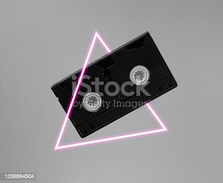 istock Video cassette. 80's synth wave and retrowave glowing triangle futuristic aesthetics. Old fashioned abstraction concept 1206894504