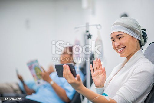 941439642 istock photo Video Chatting During IV Drip Treatment stick photo 1181263176