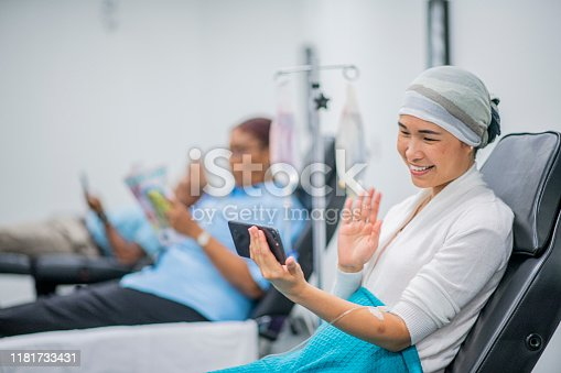 941439642 istock photo Video Chatting During IV Drip Treatment stick photo 1181733431