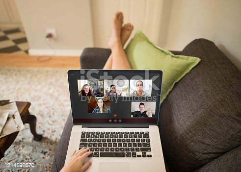 A POV photo of a group of people hanging out online on a video chat during a pandemic lockdown