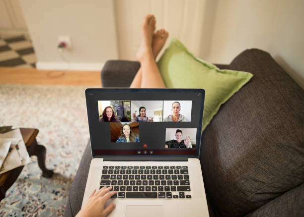 Video chatting makes social distancing easier A POV photo of a group of people hanging out online on a video chat during a pandemic lockdown flatten the curve stock pictures, royalty-free photos & images