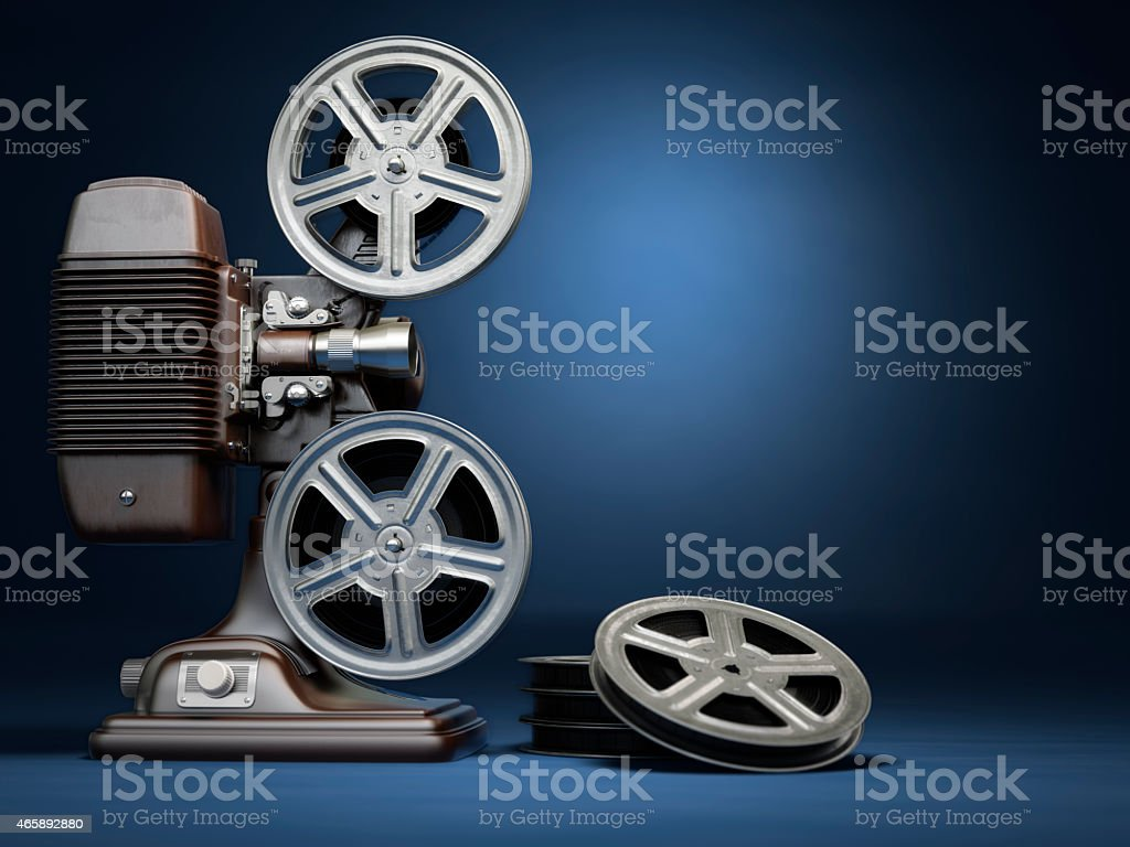 Video, cinema concept. Vintage film movie projector and reels on stock photo