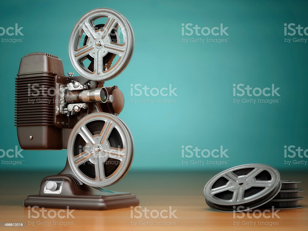 Video, cinema concept. Vintage film movie projector and reels stock photo