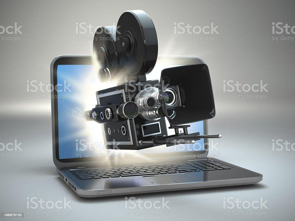 Video concept. Retro camera and  laptop. stock photo