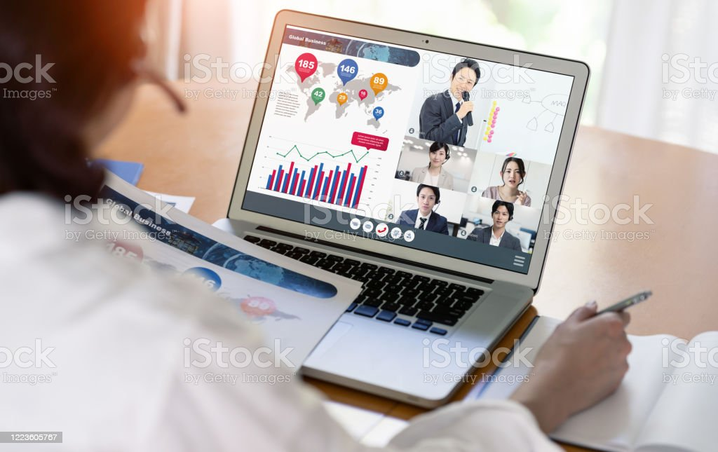 Video conference concept. Teleconference. Telemeeting. Webinar. Online seminar. e-Learning. - Royalty-free Asian and Indian Ethnicities Stock Photo
