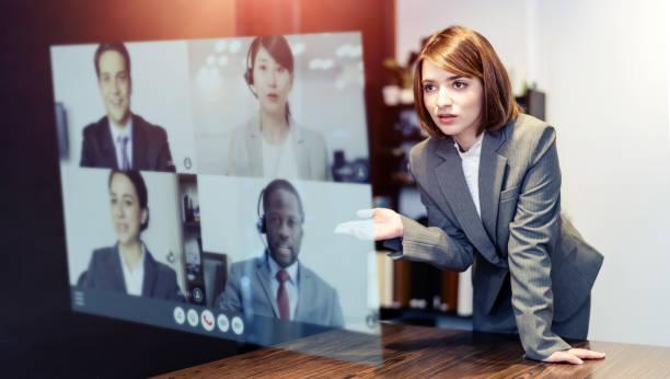 video conference concept. teleconference.  webinar. online seminar. e-learning. - business woman hologram imagens e fotografias de stock