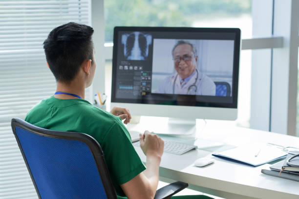 video conference with doctor - telemedicine stock pictures, royalty-free photos & images