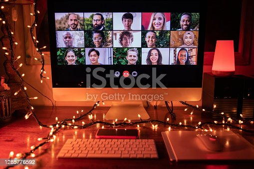 Video conference with many friends in a Christmas Eve night