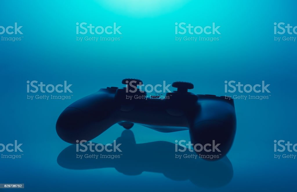 Video game controller on a reflective background stock photo
