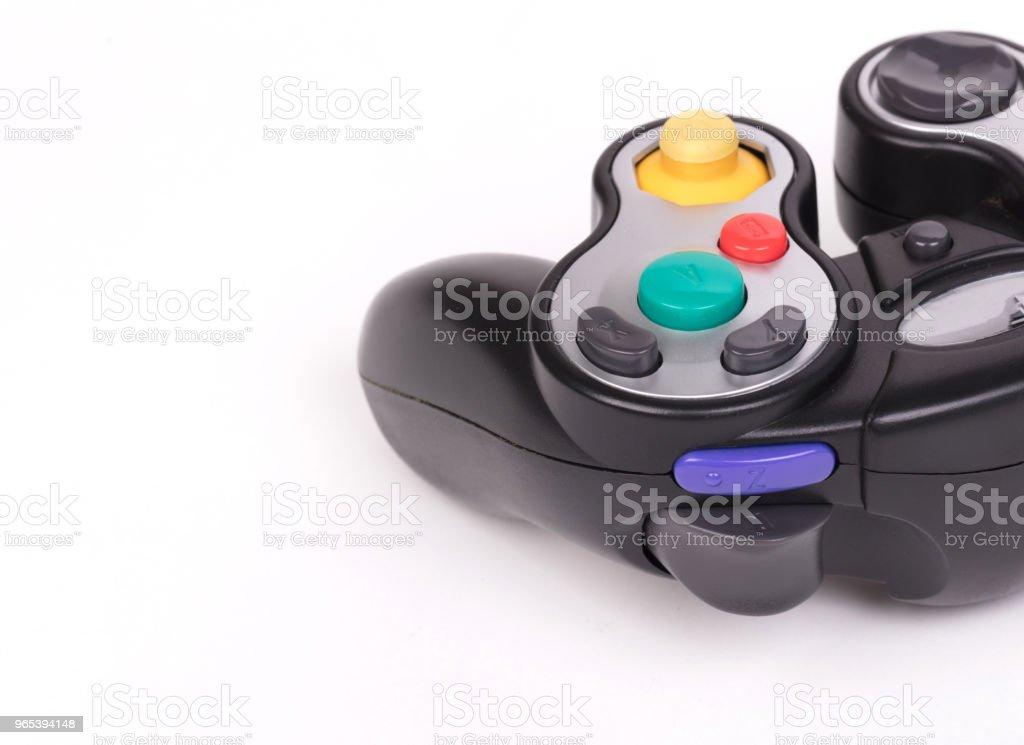 Video game controller on white background zbiór zdjęć royalty-free