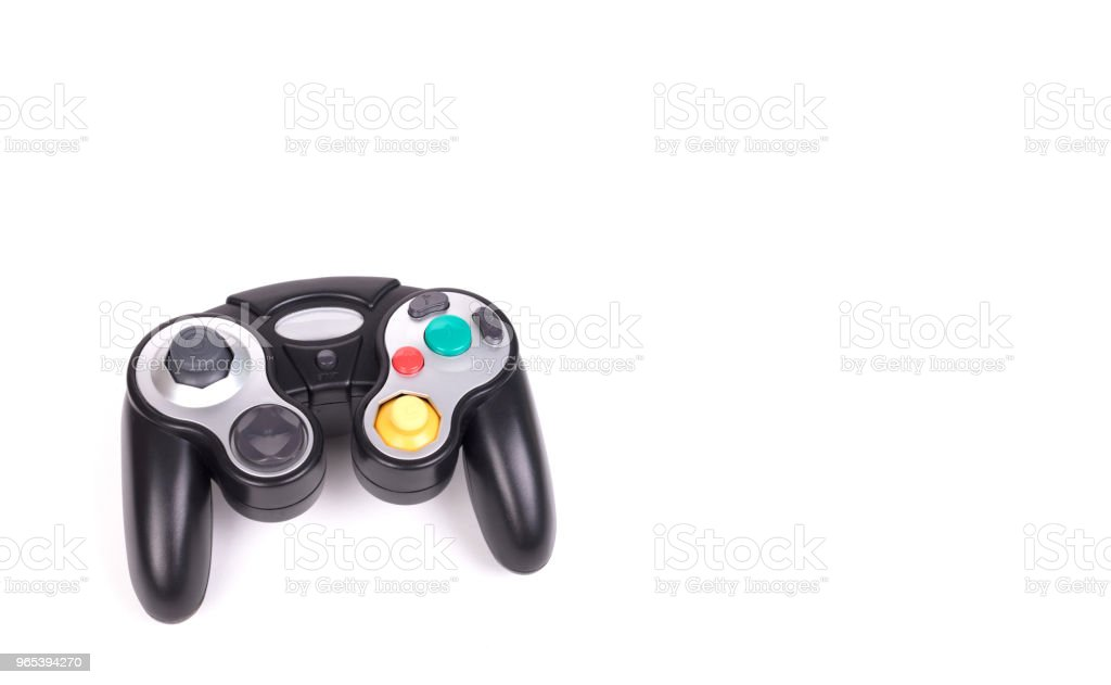 Video game controller on white background zbiór zdjęć royalty-free