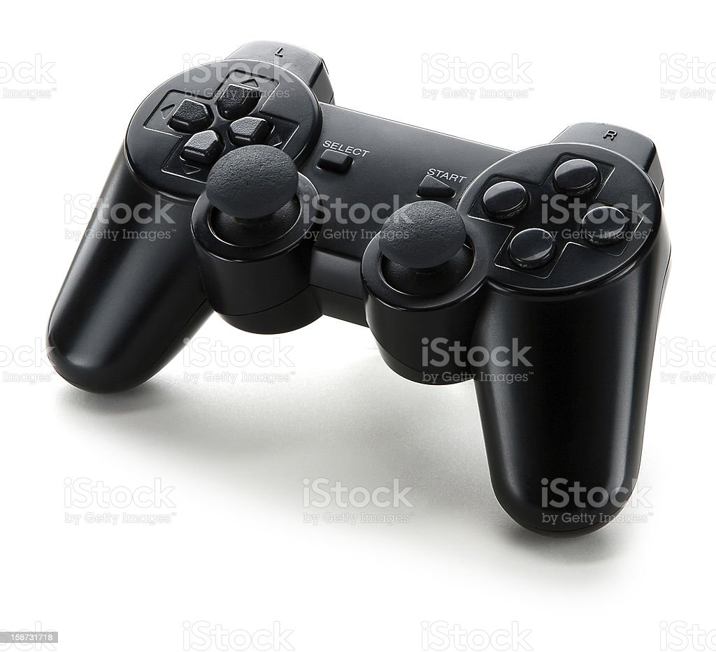 A video game controller standing on a white background stock photo
