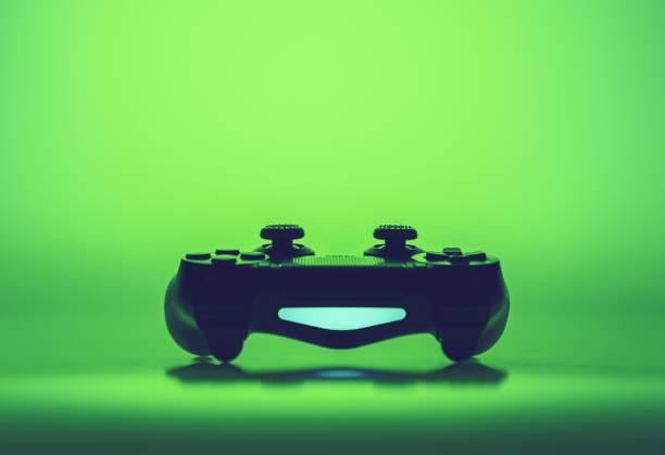Video game joystick on a vivid green background stock photo