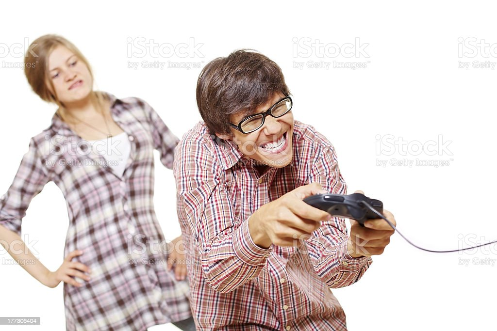 Video game teen and his angry girl royalty-free stock photo