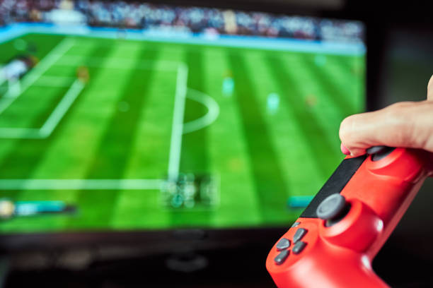 Video gamer plays with a joystick in the game stock photo